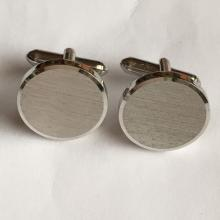 Round silver tone satin finish cufflinks, signed SWANK