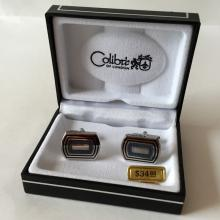 COLIBRI of London: Silver tone cufflinks with black enamel, comes in original signed black leather box