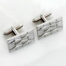 Vintage rectangular shiny and textured finish cufflinks, signed SWANK