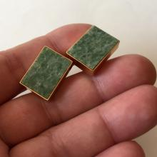 LA MODE: Gold plated rectangular marble jasper cufflinks, signed