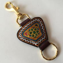 Gold tone with genuine leather key chain, embellished from one side