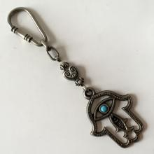JUDAICA:  Antique color key chain in shape of hand with turquoise color stone