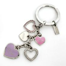 Silver tone enamel and rhinestones heart charms on key chain, signed COACH