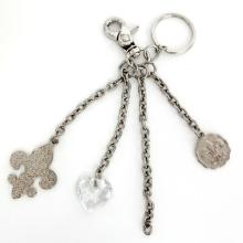 Silver tone key chain with 3 charms, signed KATHY Van Zeeland