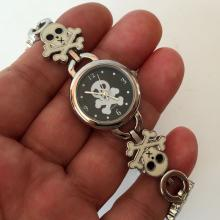 Silver tone round white and black enamel SCULL design Quartz watch with matching bracelet