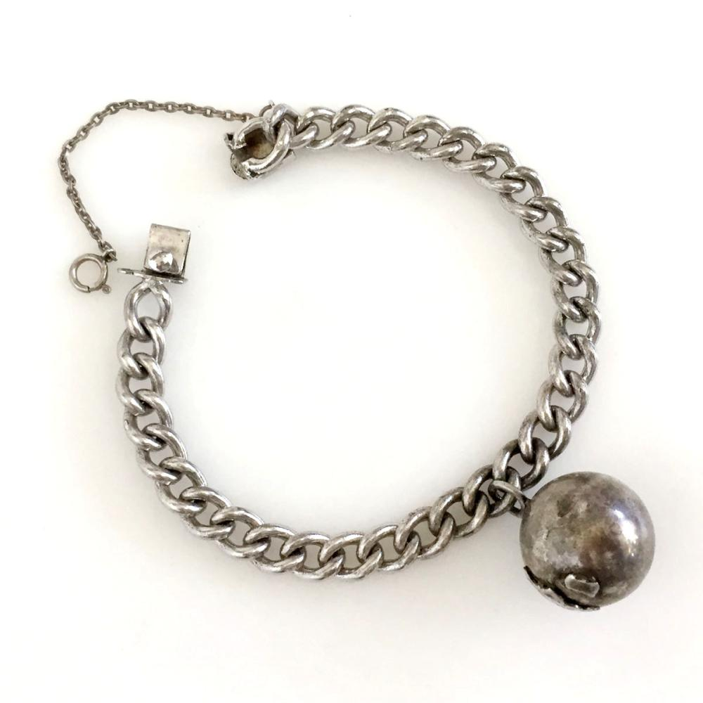 Vintage sterling silver curb link chain bracelet with Africa on the globe ball charm