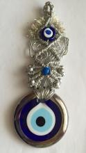 Silver tone twisted rope with attached two one small and one big evil eyes made out of blue and white color glass dangling on wall amulet