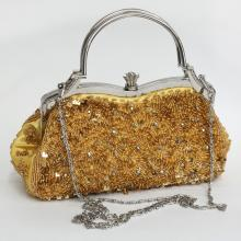 Silver tone metal with yellow gold color and silver color beads clear rhinestones yellow purse clutch with chain
