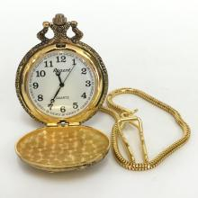 Regent quartz antique color pocket watch with gold plated snake chain. On top cover FISHERMAN figure, on back diamond cut nice design. Case measured 46 mm in diameter. Thickness 14.5 mm. Length of chain 12