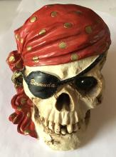Money box in shape of SCULL