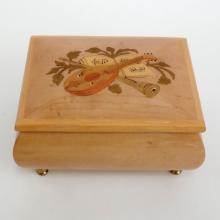 Wooden embellished on top music box on gold plated legs, made in Italy