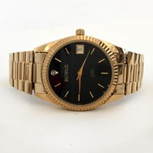 VINTAGE Benrus round gold plated watch swiss quartz date with stretchable bracelet