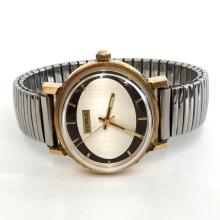 VINTAGE Benrus gold plated oval swiss quartz watch with stretchable bracelet.