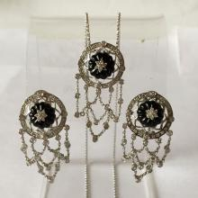 14k white gold diamonds and carved black onyx set contain omega clasp with post earrings, pendant and chain