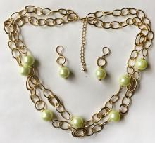 Gold plated chain links with lemon color faux round pearls between 2 lines necklace with lobster clasp and matching dangling earrings with lever backs