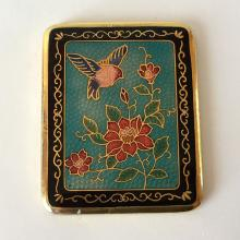 Vintage rectangular hand mirror from one side and enameled cover from back
