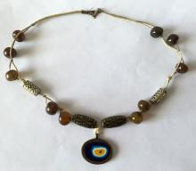 Vintage metal tube shape carved and black enameled beads with round shape brown shiny beads attached to rope necklace with oval shape