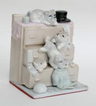 Porcelain figurine 4 PUPPIES PLAYING WITH DRAWERS