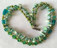Two lines green colored shells and glass beads necklace with sterling silver clasp