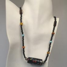 Multicolor round and black barrel shape small beads necklace with silver tone toggle clasp and big rectangular bead in the middle surrounded by silver tone spacers