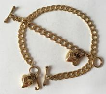 Gold plated cuban link toggle clap with heart and J charms necklace and matching bracelet, both signed JUICY COUTURE