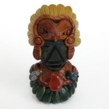 Carved black stone Native American man head in costume with genuine stones