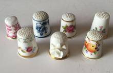 Lot of 7 porcelain thimbles, all signed. 6 made in England, 1 made in Japan