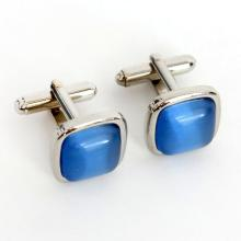 Silver tone cufflinks with cushion shape blue