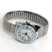 Silver tone round ladies TIMEX Date watch with textured stretchable bracelet