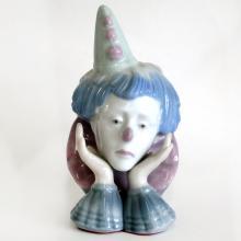 Vintage porcelain SAD PERROT Head on hands figurine statuette