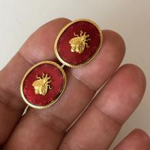 MMA 1989: Vintage gold plated oval shape red enamel with fly on top cufflinks, signed