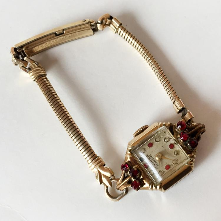 Vintage gold plated ladies BANNER SEVENTEEN watch with red and white color dial, prongs set red stones bezel, snake style chain bracelet