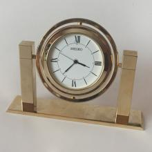 SEIKO gold tone table clock rotating QHG355G. Case measured 2 3/4