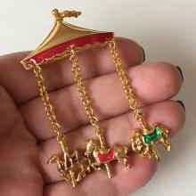 Gold plated and enamel CAROUSEL shaped brooch with dangling on chain enameled charms
