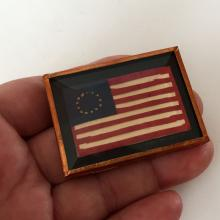 Hand made OLD AMERICAN FLAG shaped brooch covered from all sides by pink foil and colorless thick faceted plastic on top