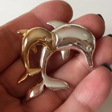 LIZ ClAIBORNE: Two tone DOLPHINS shaped brooch