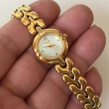 Gold plated round BULOVA Quartz West Germany movement watch with matching original bracelet, white mother of pearl and diamond dial