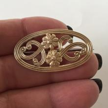 SYMMETALIC: 14k gold and sterling silver oval shaped brooch with 2 flowers, signed