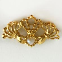 AVON: Gold plated CLADDAGH symbol shaped brooch with faux white heart shaped mother of pearl, signed