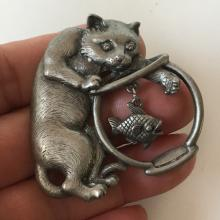 J.J.: Silver tone CAT PLAYING WITH FISH shaped brooch, signed