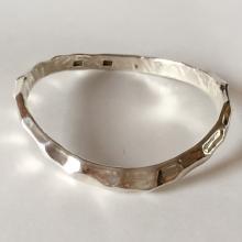 Sterling silver hammered finish wave shape bangle bracelet