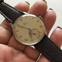 Vintage silver tone round OMEGA men's watch with genuine leather strap