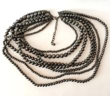 Multi strands black color faux pearls necklace with blackened metal clasp and chain extension