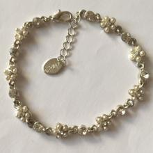 Silver tone base with glued small faux white round pearls bracelet, signed CLAIRE'S
