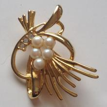 Gold plated pin brooch with white faux pearls and rhinestones