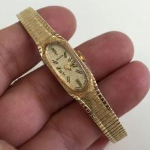 Gold plated ladies BULOVA Swiss made watch with matching textured bracelet