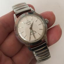 Vintage stainless steel round HILTON 17 jewels INCABLOC Swiss made watch with stretchable bracelet