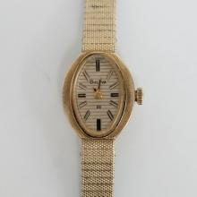 10kt rolled gold oval ladies BULOVA 23 watch with matching original textured bracelet