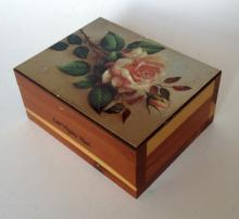 Vintage wooden box trinket with picture of rose on the top on golden color background