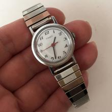 Silver tone round TIMEX ladies watch with stretchable bracelet